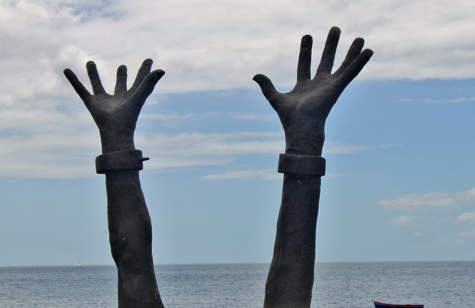 Hands showing freedom from modern slavery