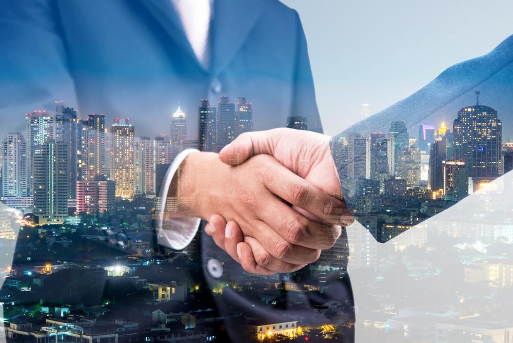 Handshake with city background