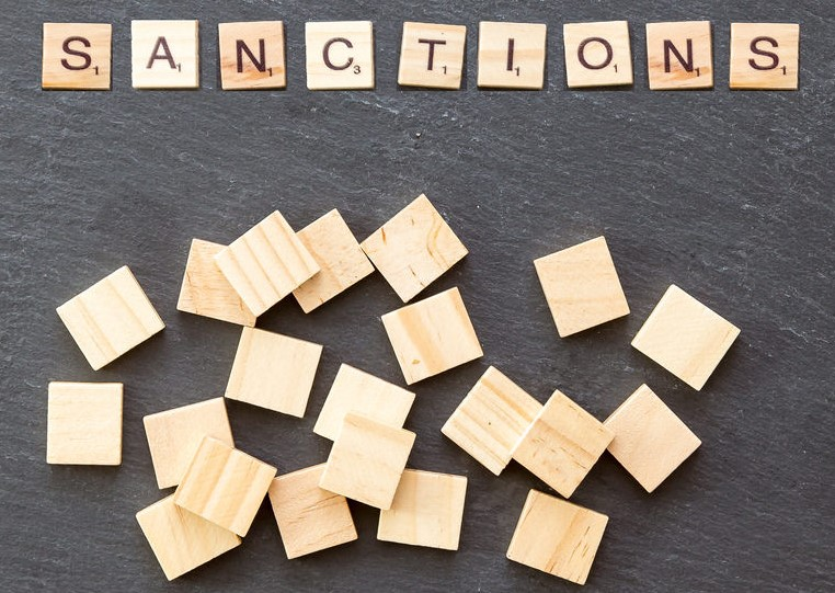 "Image of letters spelling ""sanctions"" in a game of scrabble"