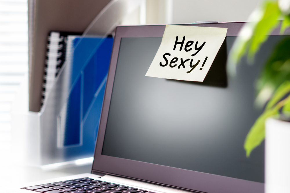 "Computer with post-it note on it saying ""hey sexy"""