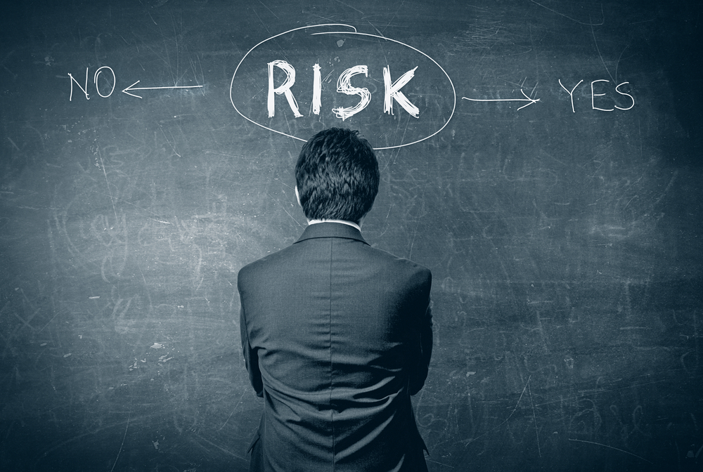Black board with the word RISK in the middle