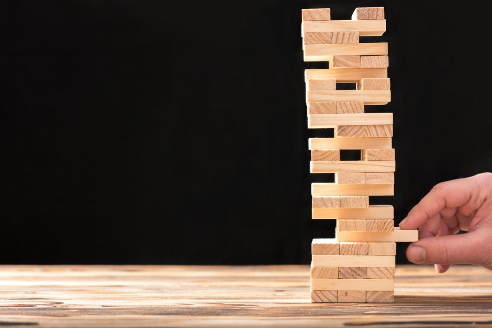 Jenga tower to show effect of awkward risks on a business