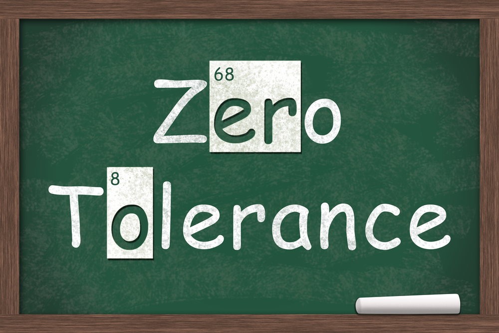 Zero tolerance written on a chalk board