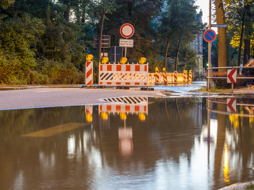 Road closed signs amid flooded water